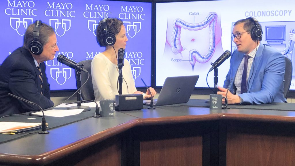 Dr. John Kisiel in the radio studio being interviewed by Dr. Shives and Tracy McCray