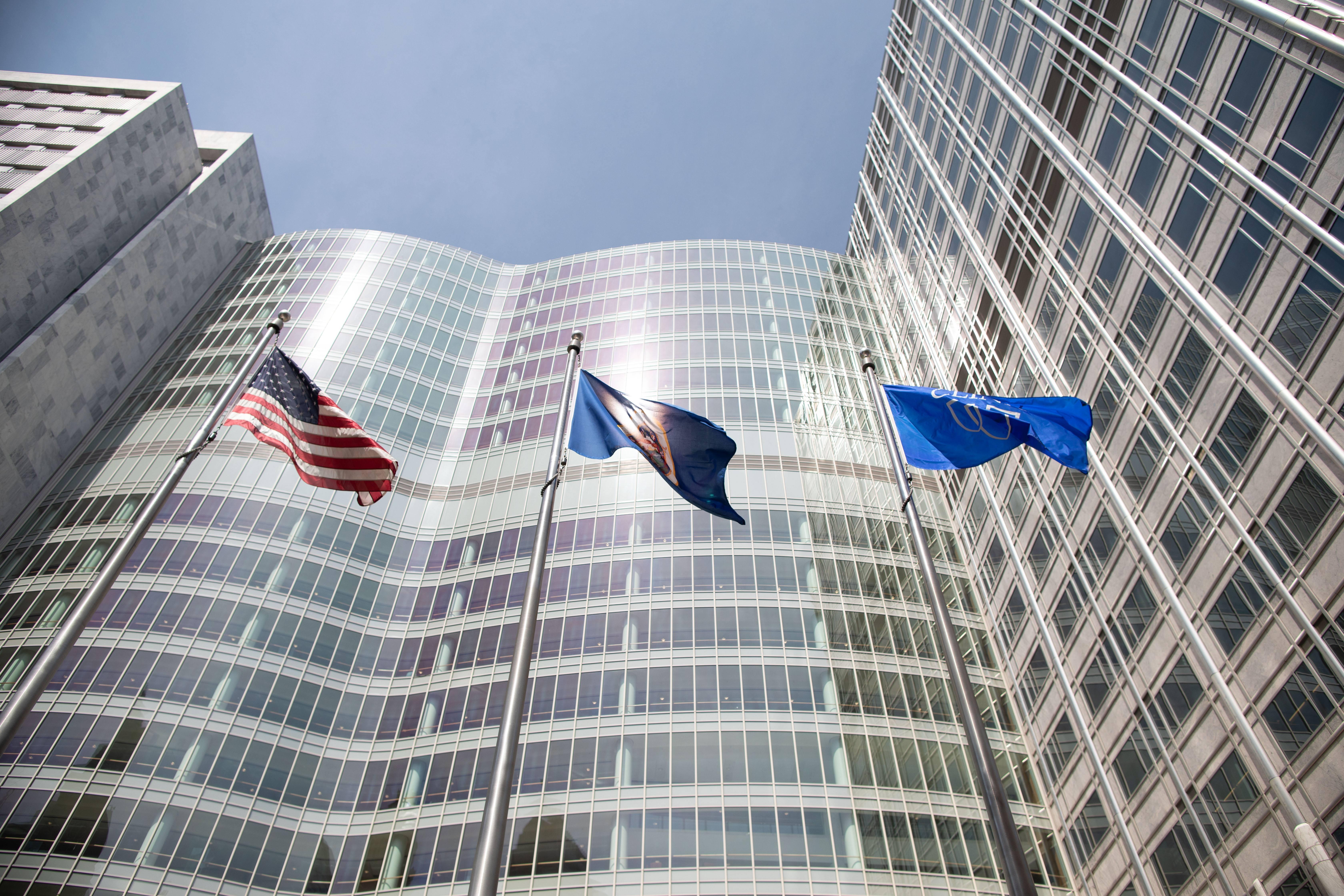 Mayo Clinic Gonda Building windows with the U.S. flag, the Mayo Clinic flag and the Minnesota State flag flying outside