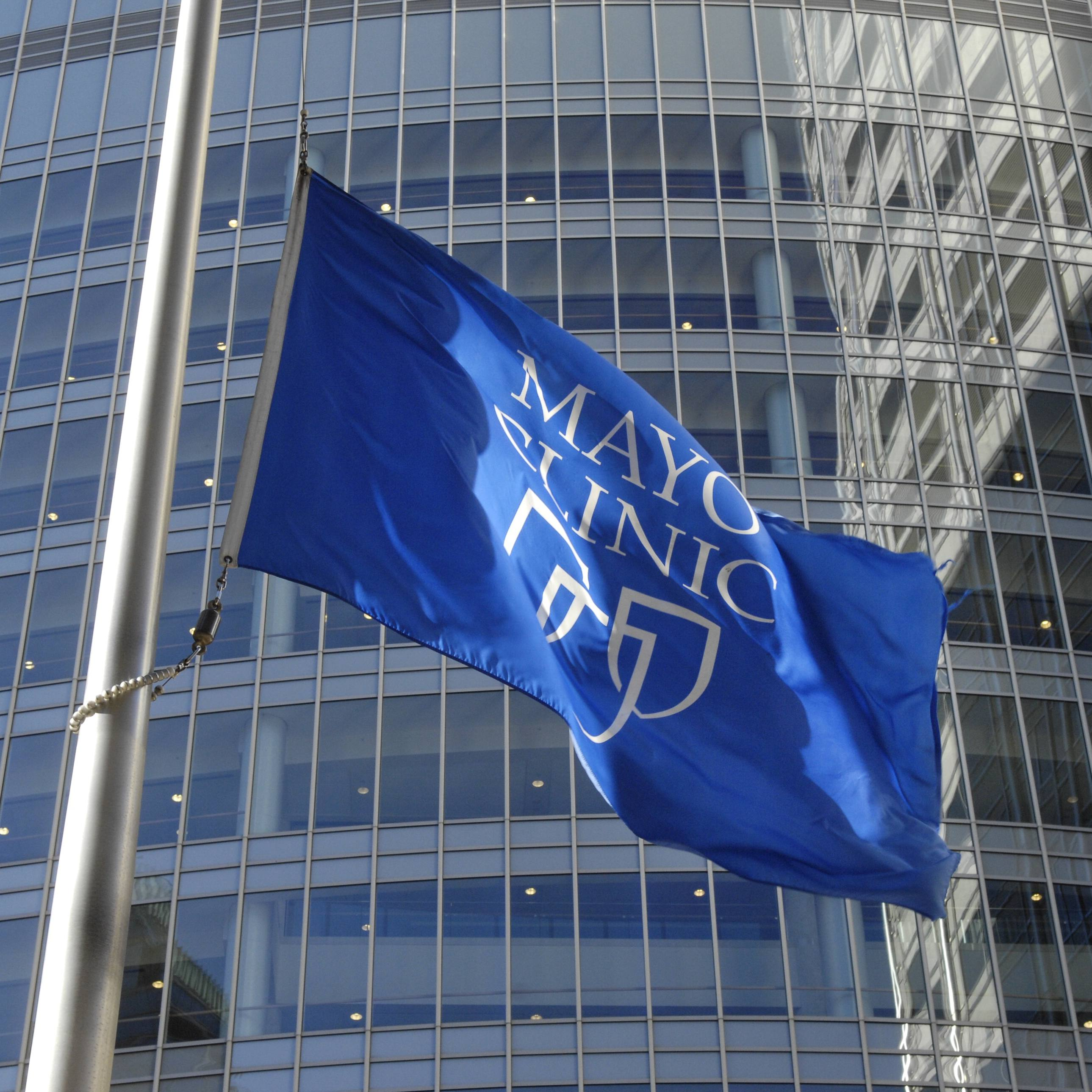 the blue and white Mayo Clinic shields flag flying outside the Gonda building windows in Rochester Minnesota