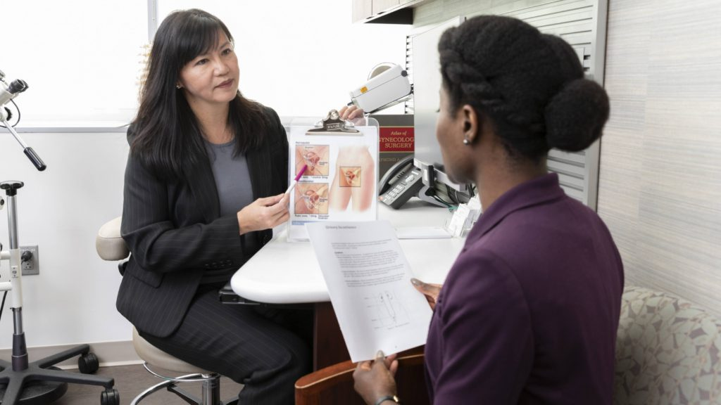 an Asian or Latina woman, medical health care provider talking with a patient, a Black woman, and sharing gynecologic diagrams