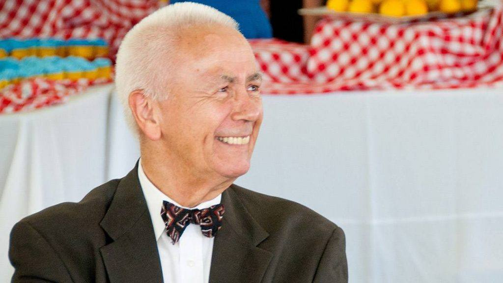 Mayo Clinic Florida leader Dr. Leo Black in a business suit with a bow tie and smiling
