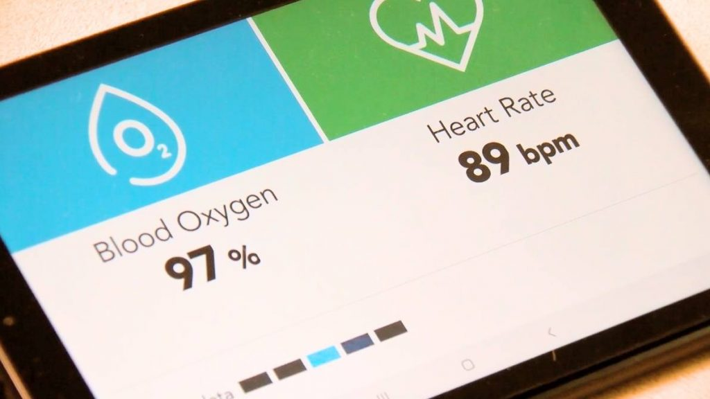 a close up of the screen for the monitoring tool that helps patients at home take their vital symptoms