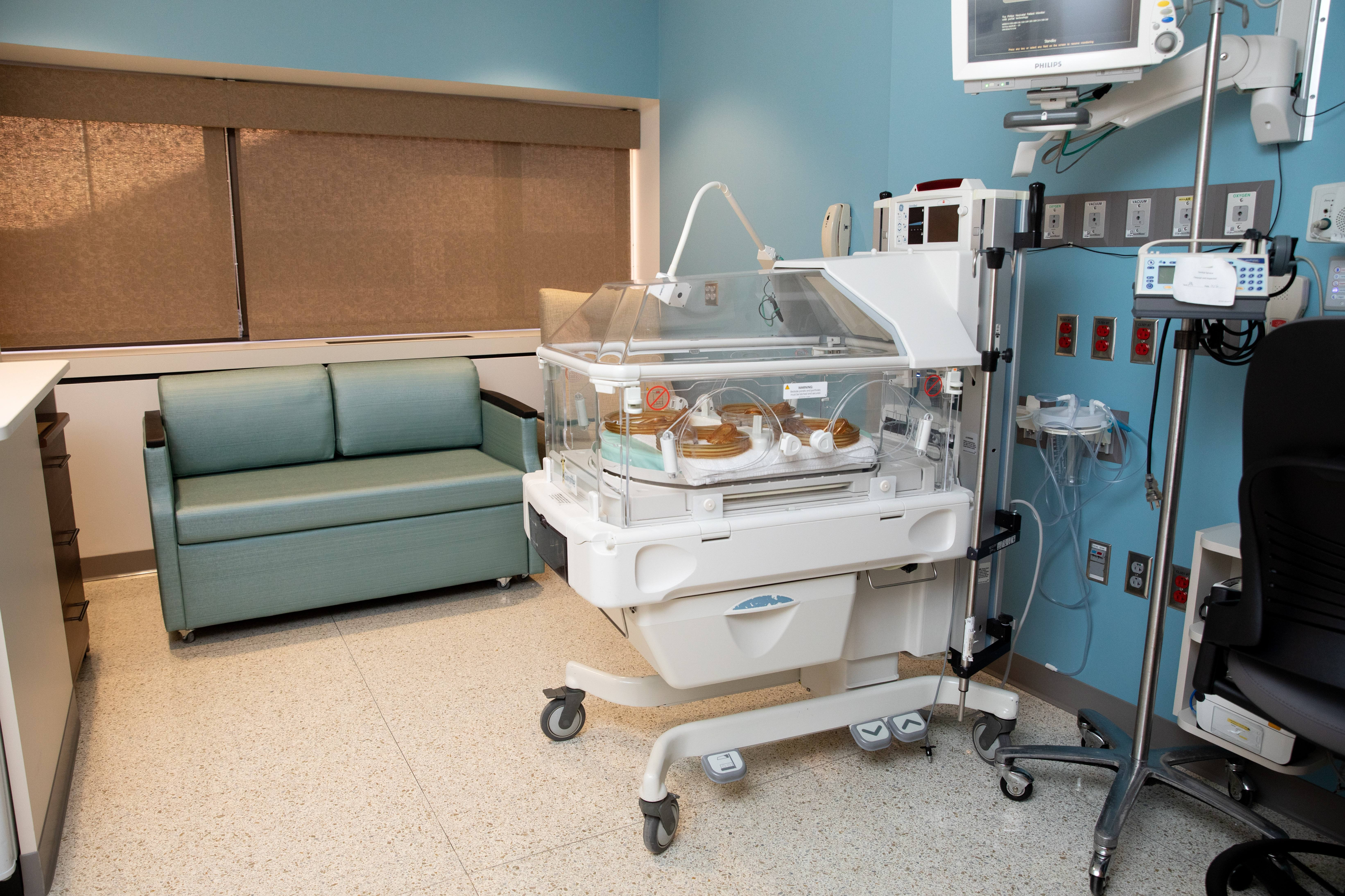 NICU room with monitors and incubator