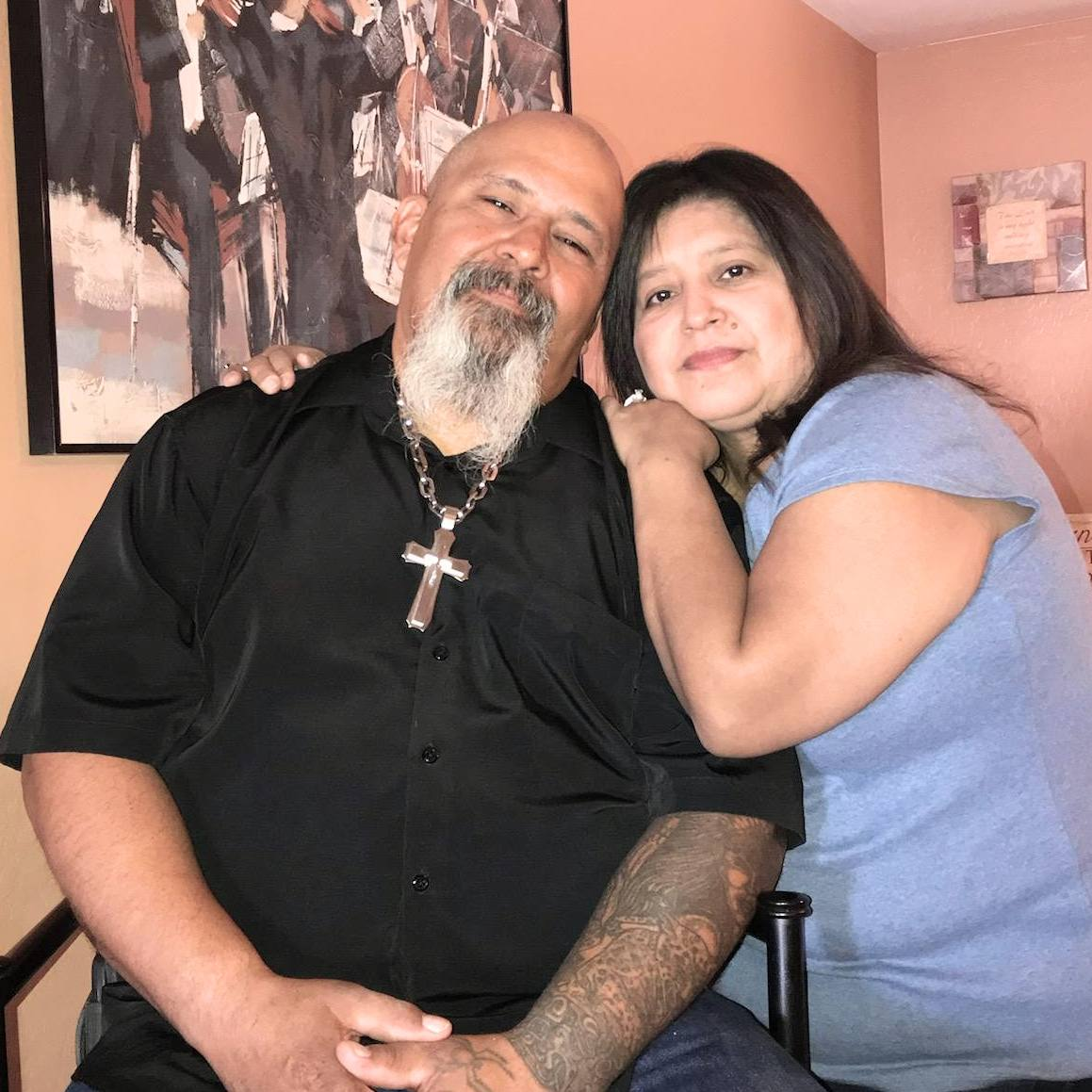heart liver transplant patient Ernie Hernandez in his home with his wife Liz leaning on his shoulder