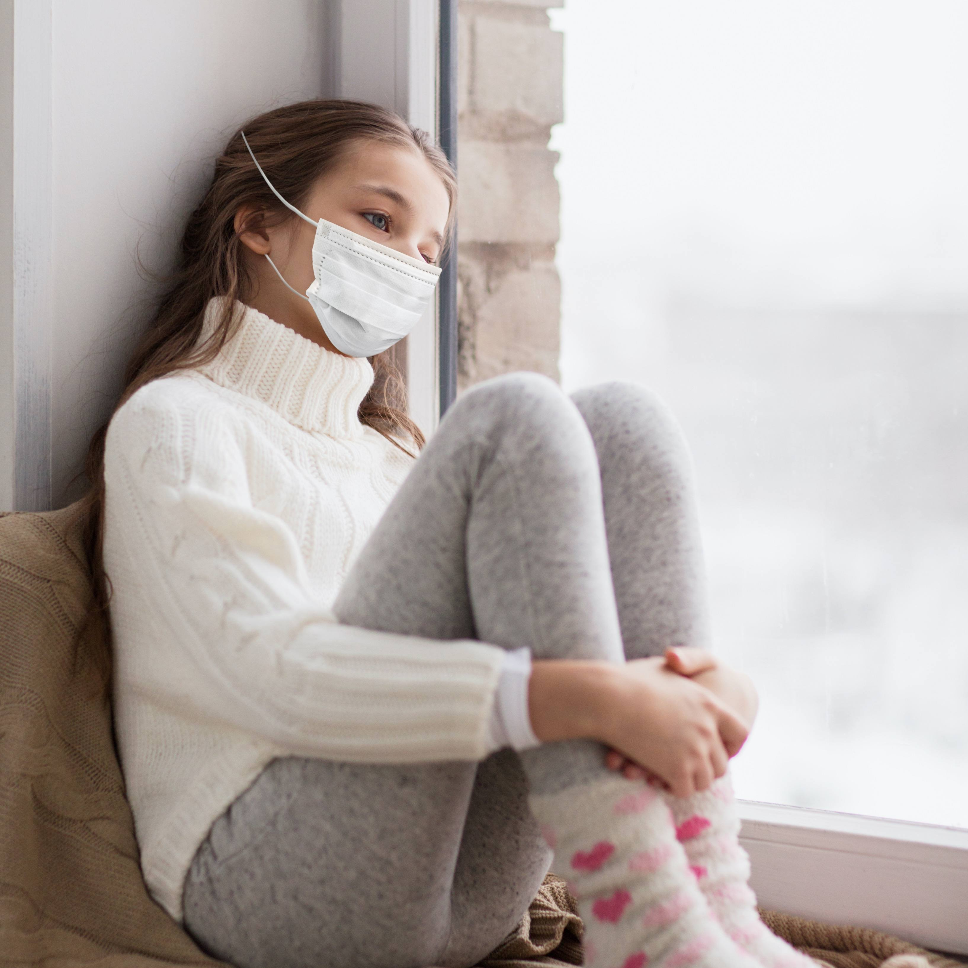 young white girl, winter inside, wearing mask