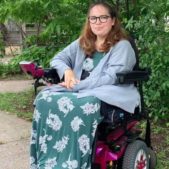 patient with spinal muscular atrophy sitting outside in a wheelchair