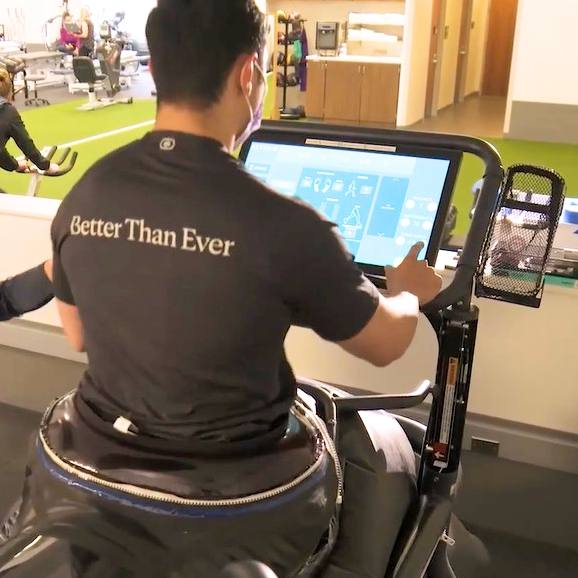 Mayo Clinic Sports Medicine trainer helping patient on treadmill for physical rehabilitation after injury
