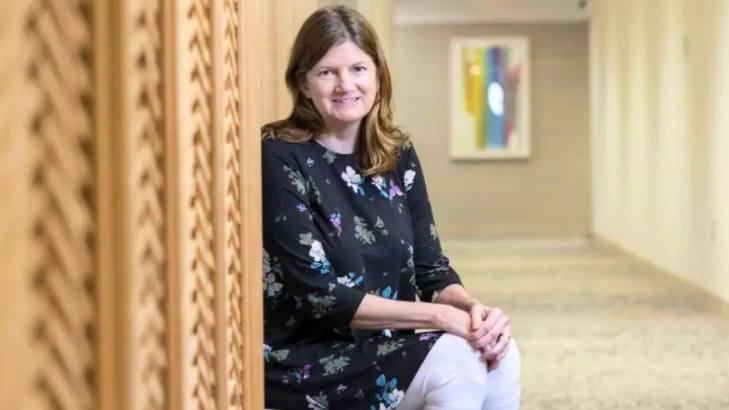 Mayo Clinic cardiac patient Elizabeth Scovil smiling and sitting a hospital hallway