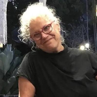 nurse-line patient Susan Fox in a black shirt and wearing glasses and smiling