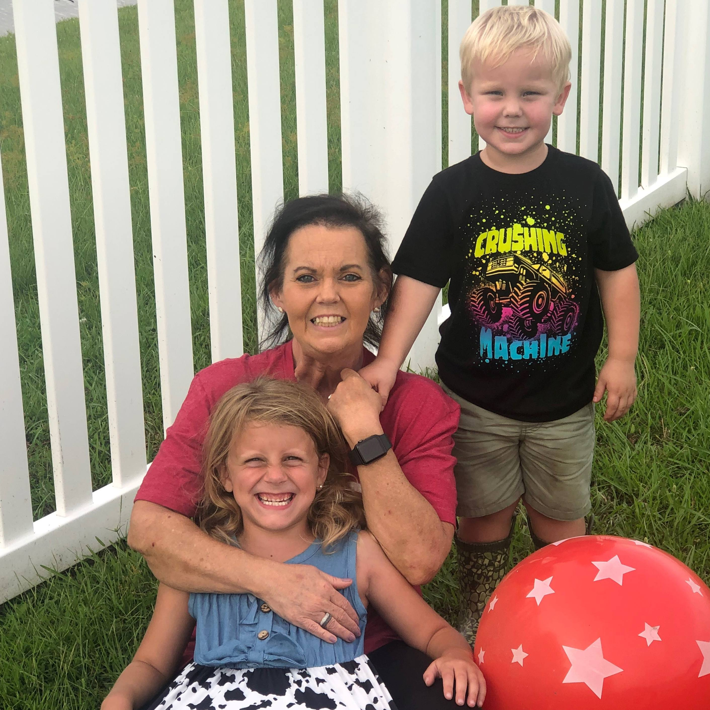 cardiac patient Sandra Driggers outside with her children playing in the grass