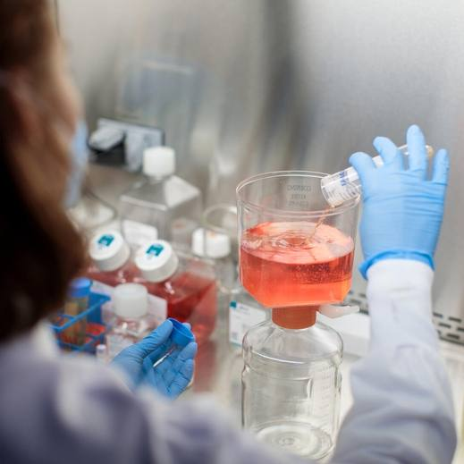 COVID-19 research in Mayo Clinic Laboratories with researcher pouring liquids into a beaker
