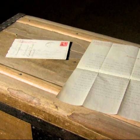 Mayo Lost-Letters-laying on an old wooden trunk