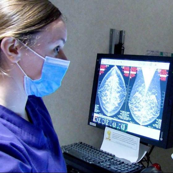 Mayo Clinic technician wearing a mask and viewing mammogram breast Xrays
